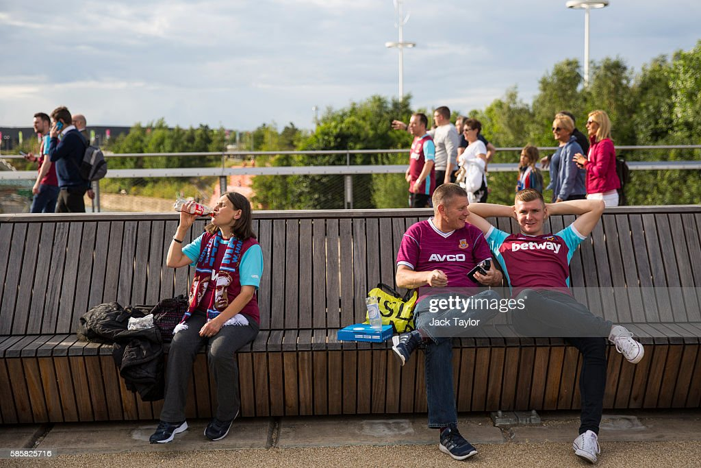Football fans wait outside the London Stadium before going in to watch West Ham United v NK Domzale on August 4, 2016 in London, England. West Ham United play for the first time tonight at the Olympic Stadium, which hosted the London 2012 Games, since moving from their former home at Upton Park.