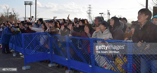Football fans wait outside the training ground after a training session ahead of the international friendly matches against Tunisia and Uzbekistan at...