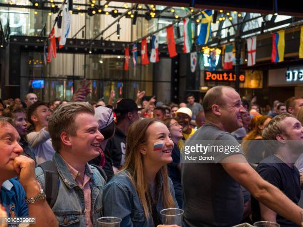 Football fans watch a match on a screen in a central Moscow bar The 21st FIFA World Cup football tournament took place in Russia in 2018 It was the...
