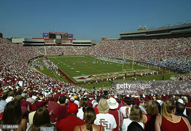 Football fans watch a play during the game between Florida State and North Carolina at Doak Campbell Stadium on October 2 2004 in Tallahassee Florida