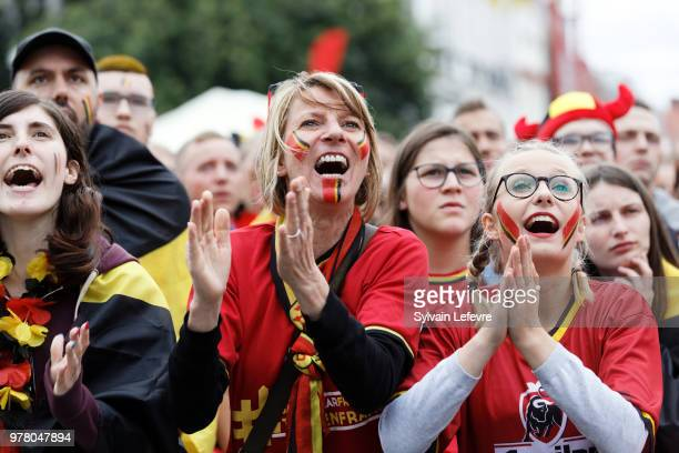 Football fans watch a screen broadcasting of the Group G match of the FIFA World Cup between Belgium and Panama at a viewing party on June 18 2018 in...