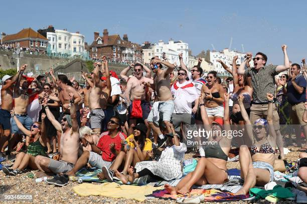 Football fans watch England take on Sweden in The World Cup Quarter Finals at Luna Beach Cinema on Brighton Beach on July 7 2018 in London England