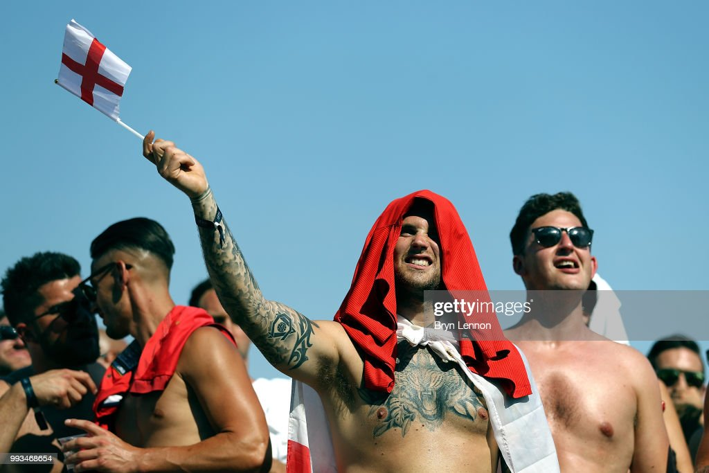 Football fans watch England take on Sweden in The World Cup Quarter Finals at Luna Beach Cinema on Brighton Beach on July 7, 2018 in London, England.