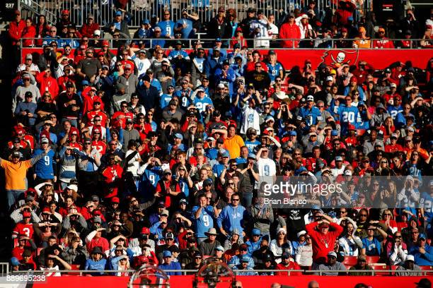Football fans watch from the stands as the Tampa Bay Buccaneers take on the Detroit Lions during the fourth quarter of an NFL football game on...