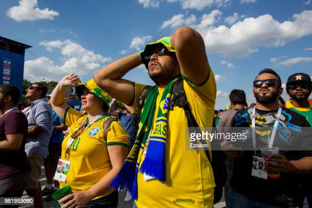 Football fans watch on screens the 2018 FIFA World Cup game Brazil vs Costa Rica at the official FIFA Fan Fest at Moscow State University during the...