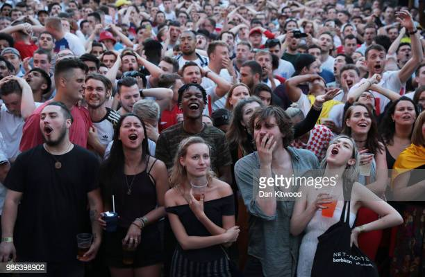 Football fans watch the 2018 FIFA World Cup Russia, group G match between England and Belgium at Flat Iron Square on June 28, 2018 in London, England.