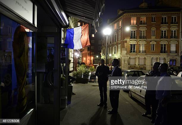 Football fans watch the FIFA World Cup 2014 football match between France and Ecuador on June 25 2014 at a bar in Paris Tenman Ecuador bravely held...