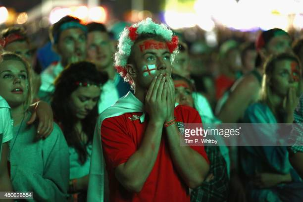 Football fans watch the first England game of The World Cup during The Isle of Wight Festival at Seaclose Park on June 14, 2014 in Newport, United...