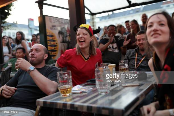 Football fans watch the World Cup match between England and Belgium in a bar on June 28 2018 in Brussels Belgium Both England and Belgium are assured...