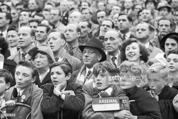 Football fans watching Arsenal in action against Glasgow Rangers at the Arsenal ground in Highbury London Original Publication Picture Post 5596 'A'...