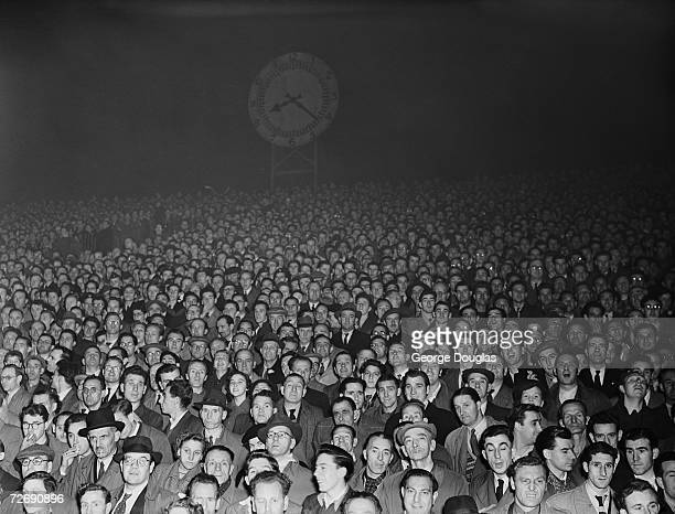 Football fans watching Arsenal in action from the Clock End at the Arsenal Stadium in Highbury London 1st December 1951 Original Publication Picture...