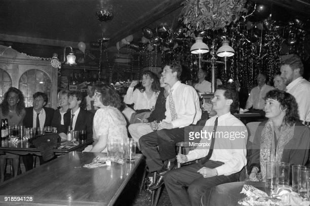 Football fans watching England in their semifinal match during the 1990 FIFA World Cup at the Three Men in a Boat pub 4th July 1990