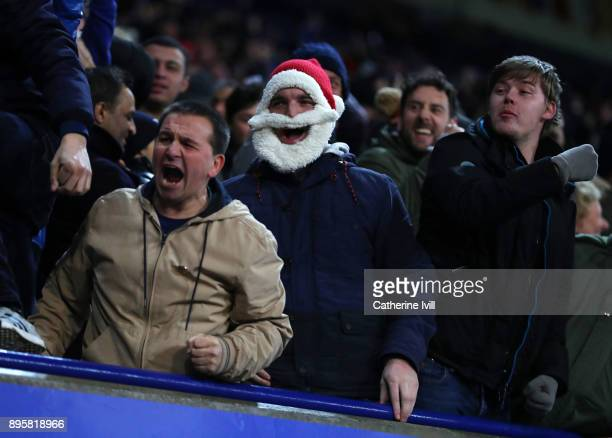Football fans wearing a Santa hat during the Carabao Cup QuarterFinal match between Leicester City and Manchester City at The King Power Stadium on...