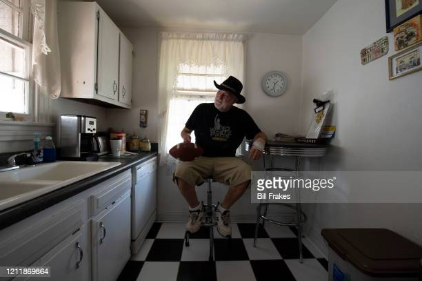 Feature Former kicker Tom Dempsey holding football in his kitchen at home New Orleans LA CREDIT Bill Frakes
