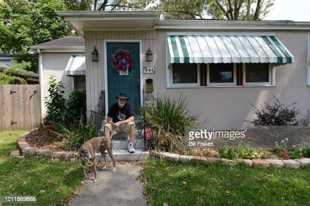 Feature Former kicker Tom Dempsey with his dog on his steps outside his home New Orleans LA CREDIT Bill Frakes