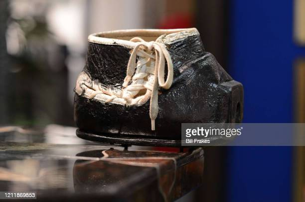 Feature Portrait of a custom flatfront kicking shoe worn by Tom Dempsey during his playing days Dempsey was born with no toes on his right foot This...