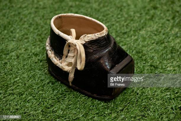 Portrait of a custom, flat-front kicking shoe worn by Tom Dempsey during his playing days. Dempsey was born with no toes on his right foot. This shoe...