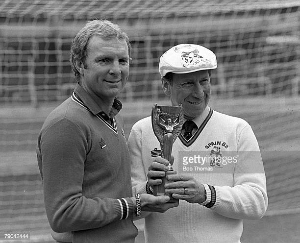 Football February 1982 England 1966 World Cup heroes Bobby Moore and Bobby Charlton holding a replica of the Jules Rimet World Cup trophy at Wembley...