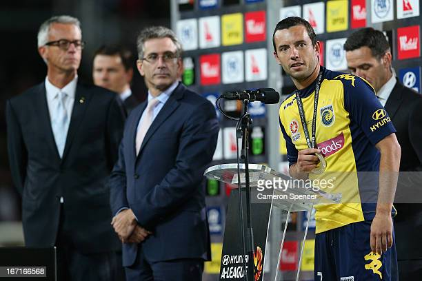 Football Federation Australia CEO David Gallop watches on as Mariners captain John Hutchinson thanks the crowd after winning the ALeague 2013 Grand...