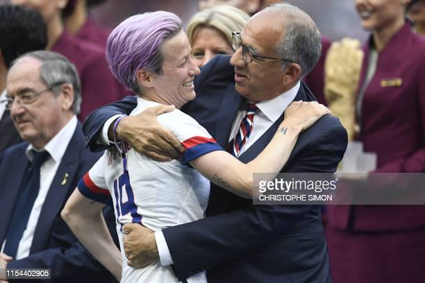 US Football Federation president Carlos Cordeiro embraces United States' forward Megan Rapinoe after the France 2019 Womens World Cup football final...