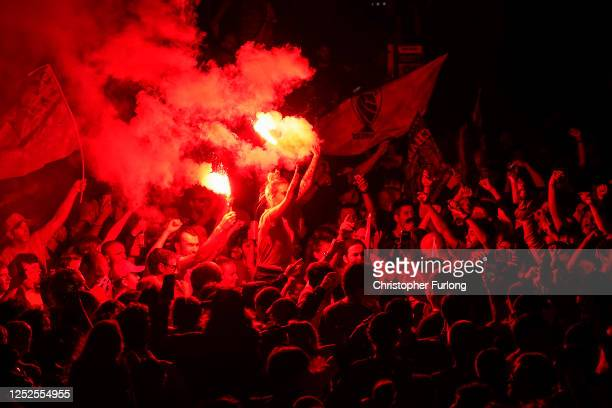 Football Ffans celebrate at Anfield Stadium as Liverpool FC win the Premier League title after Chelsea beat Manchester City tonight ensuring...