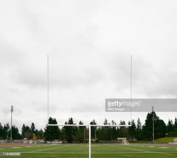 football field and goalpost - high school football stock pictures, royalty-free photos & images