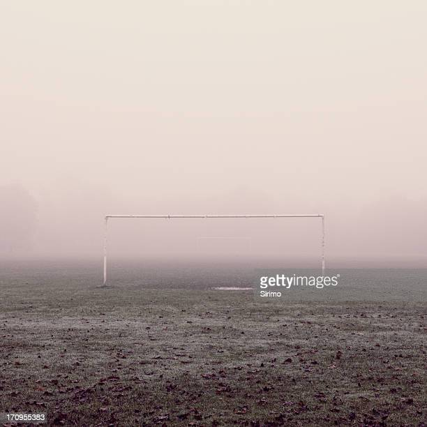 football field in the fog - goal post stock photos and pictures