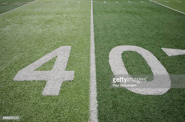 football field marking of 40 yard line - forty yard line stock pictures, royalty-free photos & images