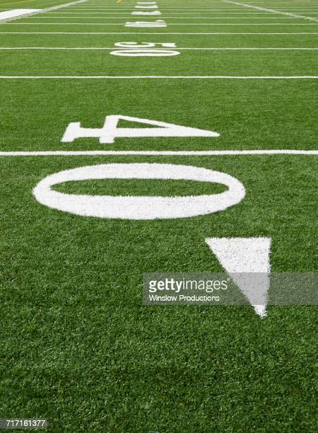 football field marking of 40 yard line - number 40 stock photos and pictures
