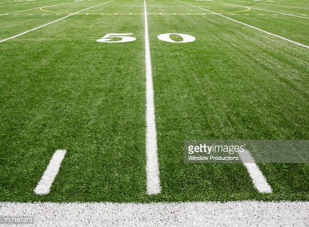 football field marking of 50 yard line - american football pitch stock pictures, royalty-free photos & images