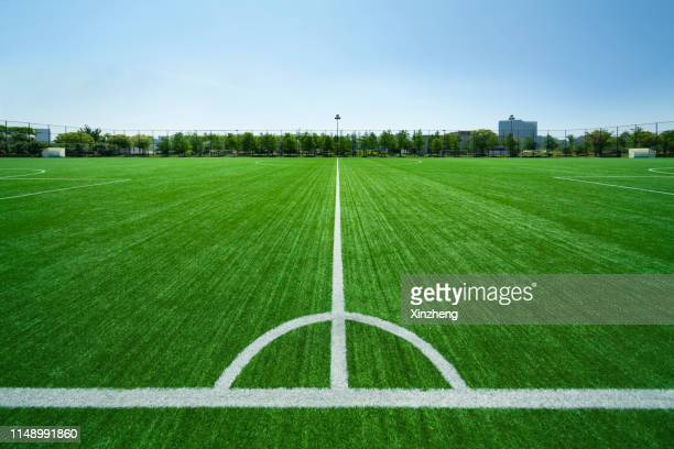 football field, painted lines on soccer field - football pitch stock pictures, royalty-free photos & images