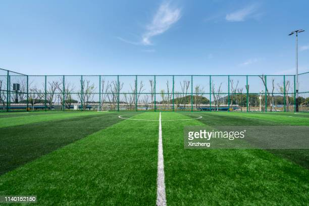 football field - track and field stadium stock pictures, royalty-free photos & images