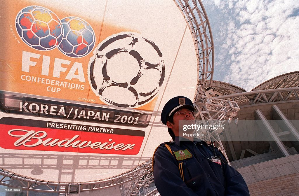 Football. FIFA Confederations Cup. 2nd June 2001. Niigata, Japan. Cameroon 0 v Japan 2. A security guard stands in front of advertising for the 2002 World Cup Finals at the Niigata Stadium. : ニュース写真