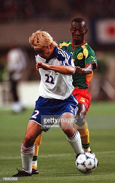 Football, FIFA Confederations Cup, 2nd June 2001, Niigata, Japan, Cameroon 0 v Japan 2, Japan's Takayuki Suzuki is challenged by Cameroon's Nicolas...