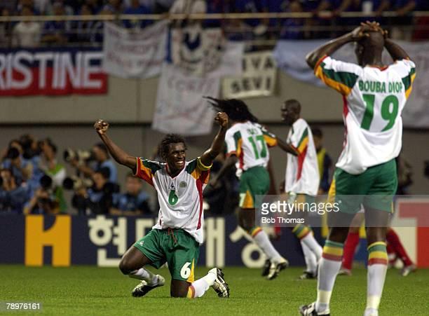 Football FIFA World Cup Finals Korea Seoul 31st May 2002 France 0 v Senegal 1 Senegal's Aliou Cisse celebrates victory as goalscorer Papa Bouda Diop...