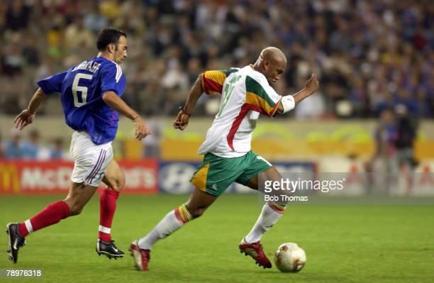 Football FIFA World Cup Finals Korea Seoul 31st May 2002 France 0 v Senegal 1 Senegal's Hadji El Diouf chased by France's Youri Djorkaeff