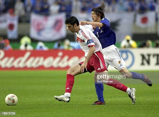 Football FIFA World Cup Finals Miyagi Japan 18th June 2002 Japan 0 v Turkey 1 Turkey's Hakan Sukur challenged by Japan's Naoki Matsuda