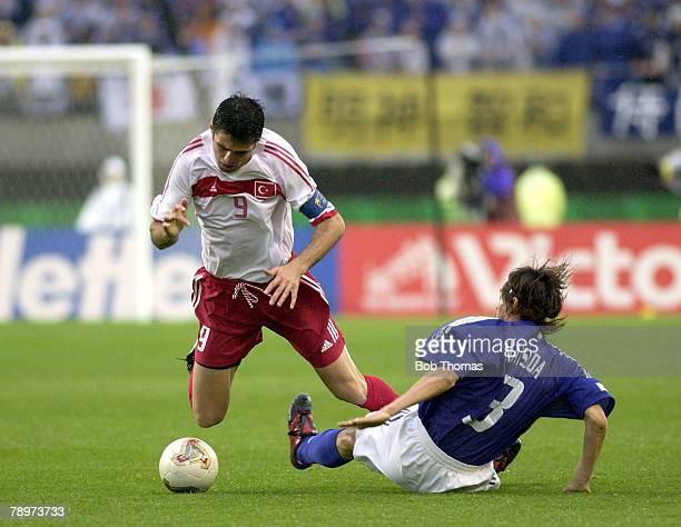 Football FIFA World Cup Finals Miyagi Japan 18th June 2002 Japan 0 v Turkey 1 Turkey's Hakan Sukur tripped up by Japan's Naoki Matsuda