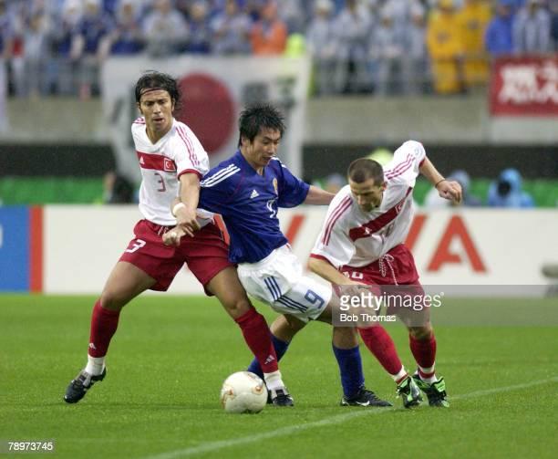 Football FIFA World Cup Finals Miyagi Japan 18th June 2002 Japan 0 v Turkey 1 Japan's Akinori Nishizawa tries to escape the challenges of Turkey's...