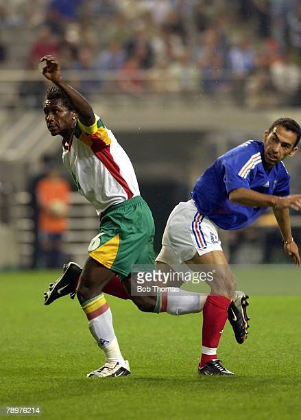 Football FIFA World Cup Finals Seoul 31st May 2002 France 0 v Senegal 1 Senegal's Aliou Cisse with French midfielder Youri Djorkaeff