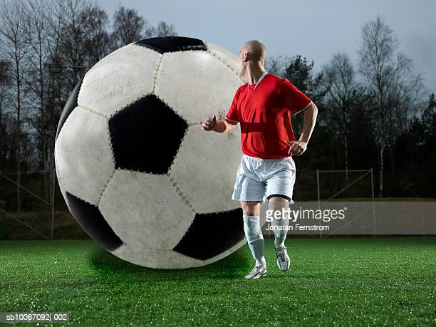 football following football player - man with big balls stock photos and pictures