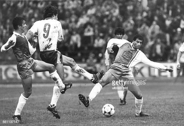 Football friendly match in Aue East Germany vs Algeria 52 Scene of the match fltr Meghichi Ralf Minge Bouiche