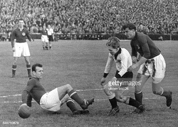 Football friendly match in Ludwighafen Fed Rep of Germany vs Yugoslavia 32 scene of the match duel between Bernhard Termath in action december 21 1952