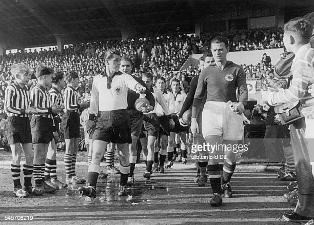 Football friendly match in Ludwighafen Fed Rep of Germany vs Yugoslavia 32 team captains Fritz Walter und Bobek enter the stadium with their teams...