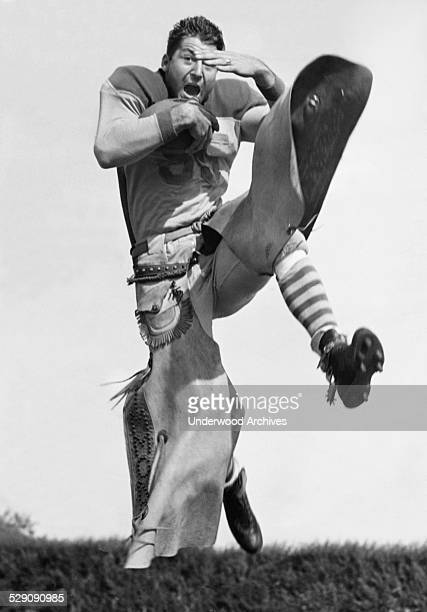 Football fullback WJ Ford of the Hardin Simmons University Cowboys shows his talent in full cowboy regalia Abilene Texas September 22 1938