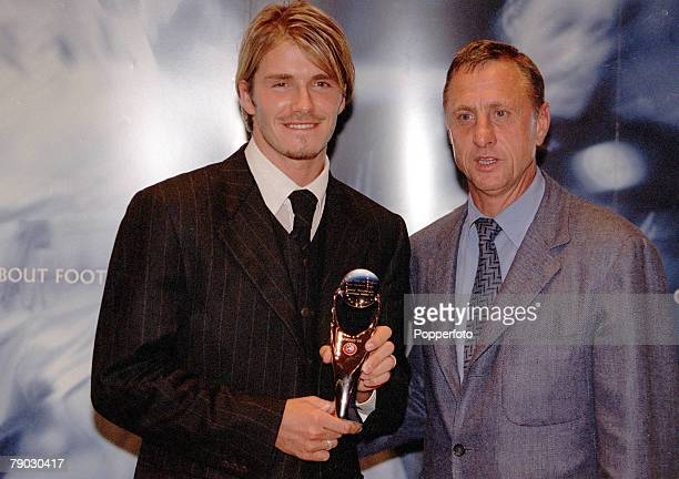 Football Gala Monaco 26th August Manchester United's David Beckham receives the Most Valuable Player Award from Johan Cruyff