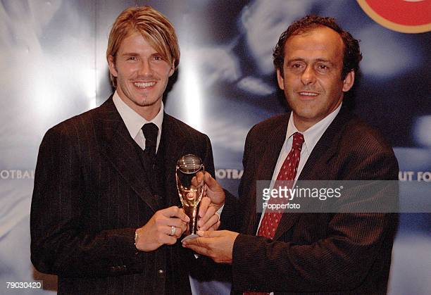Football Gala Monaco 26th August Manchester United's David Beckham receives the UEFA Best Midfielder Award from Michel Platini