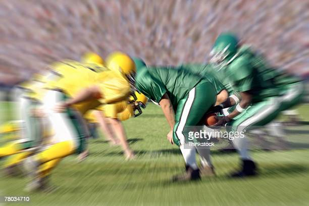 football game - defensive tackle american football player stock pictures, royalty-free photos & images