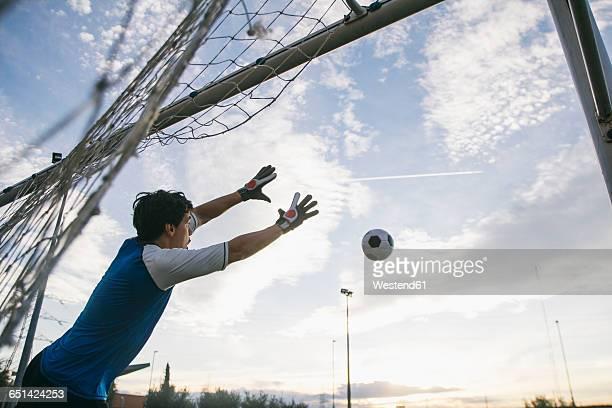 football goalkeeper making a safe - hacer un gol fotografías e imágenes de stock
