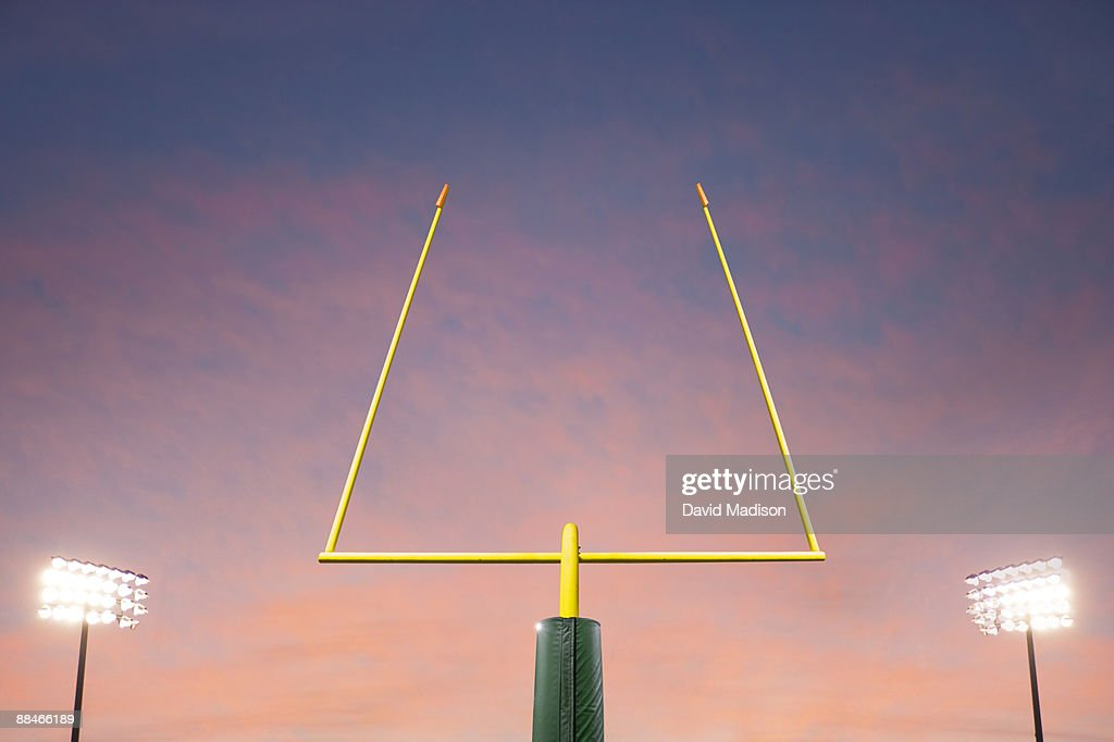 Football goalpost and lights. : ストックフォト